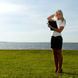 Girl with a folder on the background of the sea — Stock Photo