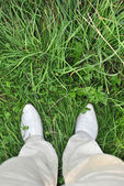 Shoes on the grass. A point of view shot — Stock Photo