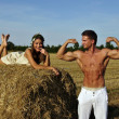 Bodybuilder with a girl in the countryside — Stock Photo