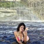Girl in bikini lying near a waterfall — Stock Photo #6678205