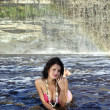 Girl in bikini lying near waterfall — Foto Stock #6678205