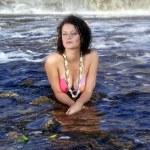 Girl in bikini lying near a waterfall — Stock Photo #6678211