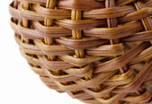 Wicker basket on a white background — Stock Photo