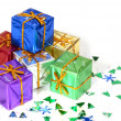 Six brightly colored wrapped Christmas presents — Stock Photo