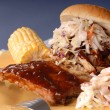 Pulled pork sandwich, ribs — Stock Photo