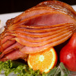 Honey glazed Easter ham with fruit and carrots — Stock Photo #5978842