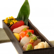 Fresh seafood sushi nigiri with lemon and flowers - Stock Photo