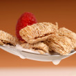 Whole wheat shredded cereal with raspberry — Stock Photo