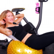 Stock Photo: Attractive womdoing situps on exercise ball