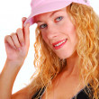 Young woman trying on pink sports hat — Stock Photo