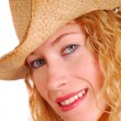 Stock Photo: Young womwearing cowboy hat