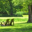 Adirondack chairs in a country setting - Stock Photo