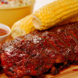 Stock Photo: BBQ RIbs with corn on cob