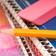 Pencil and eraser resting on notebooks — Stock Photo #5979385
