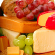 Assortment of cheese and fruit - Stock Photo