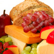 Assorted fruits and cheeses — Stock Photo