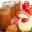 Preserving freshly made applesauce — Stock Photo