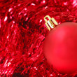 Red Christmas ornament on garland — Stock Photo #5979444