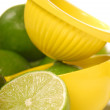 Lime with citrus juicer - Stock Photo