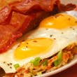 Eggs, bacon, toast and hash browns - Stock Photo