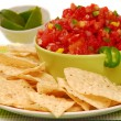 Tortilla chips with salsa and lime - Stok fotoğraf