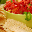 Tortilla chips with salsa and lime — Stock Photo #5979621
