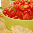 Tortilla chips with salsa and lime — Stock Photo #5979623