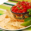 Tortilla chips with salsa and lime — Stock Photo #5979628
