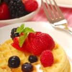 Waffles with fresh fruit — Stock Photo