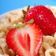 Постер, плакат: Bowl of oat cereal with strawberries