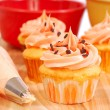 Halloween cupcakes being frosted — Stock Photo #5979674