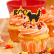 Halloween cupcakes being frosted - Stock Photo