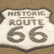 Route 66 sign on pavement - Stock Photo
