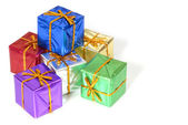 Six brightly colored wrapped Christmas packages — Stock Photo
