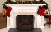 White fireplace decorated for Christmas — Stock Photo