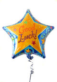 "A festive helium filled balloon with ""Good Luck"" written on it. — Stock Photo"
