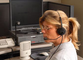 Police dispatcher sitting at a dispatch console — Stock Photo