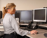 Police dispatcher working at console — Stock Photo