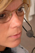 Close up of a police dispatcher's face — Stock Photo
