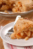 Slice of deep dish apple pie — Stock Photo
