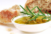 Bowl of olive oil with rosemary and bread — Stock Photo