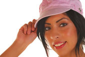 Attractive latino woman tipping her hat — Stock Photo