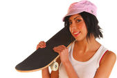Young woman holding skateboard — Stock Photo