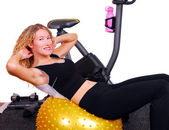 Attractive woman doing situps on an exercise ball — Stock Photo
