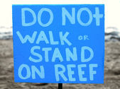 Do not stand on reef sign — Stock Photo