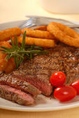 Grilled Steak with Onion Rings — Stock Photo