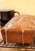 Cherry and raisin bread with lemon icing — Stock Photo