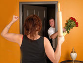 Man coming home late to angry wife — Stock Photo
