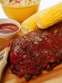 BBQ Ribs with cole slaw, corn and dipping sauce — Stock Photo
