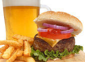 Cheeseburger with french fries and beer — Stock Photo